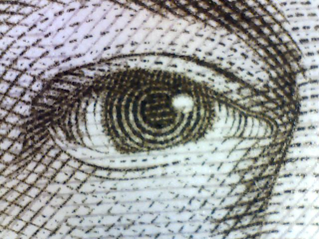Magnified image of the queen's eye from a £10 note
